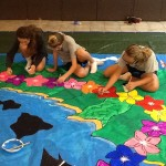 middle school girls painting flowers