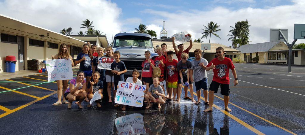 student council and 8th graders at car wash