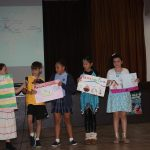 Kids presenting counties for Cultural Awareness Day
