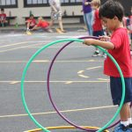 boy with hula hoops