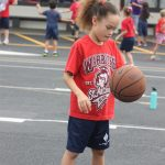 girl dribbling basketball at Jump Rope for Heart
