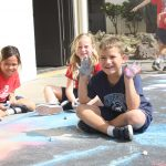 kids drawing on pavement at SAS