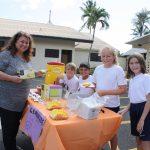 Principal makes purchase at lemonade stands
