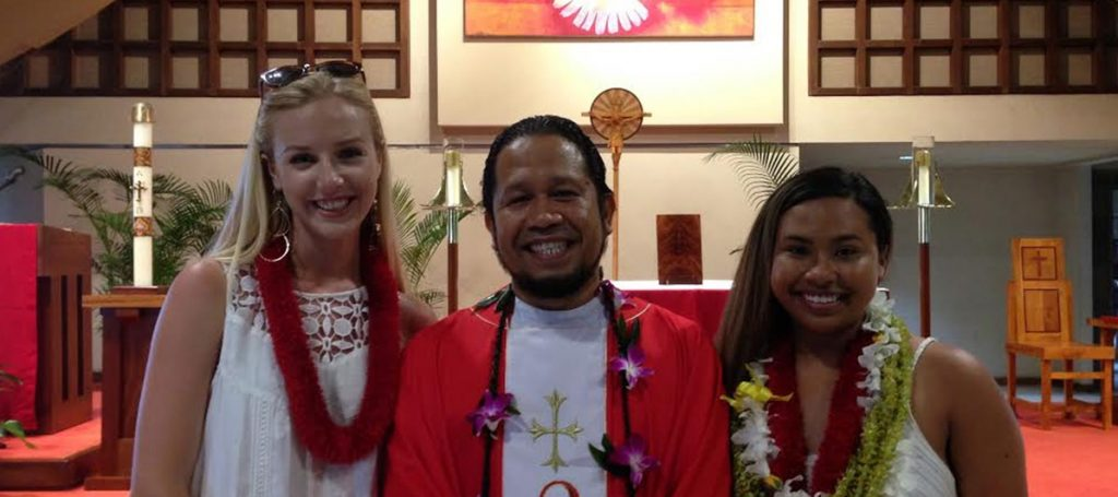 Zoey Balmy and Tiana DeCosta with Father Exsequel after receiving the Sacrament of Confirmation