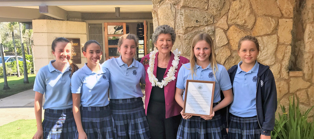 Senator Cynthia Thielen presents Grace Kennedy (second from the right) with a Proclamation from the Hawaii State Legislature congratulating her on her accomplishment. With Grace is Iwi Kea Maxey, Henna Chong-Tim, Makayla Seeger and Maile Seeger, SAS students who worked on Kidz for a Cause.